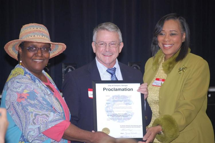 ER Shipp, Mayor Vince Evans, Katrina Young with Proclamation from 2019 Symposium